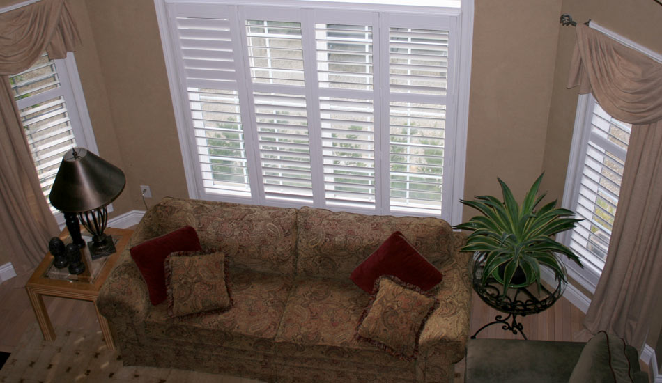 Drapery can be a nice soft addition around your shutters
