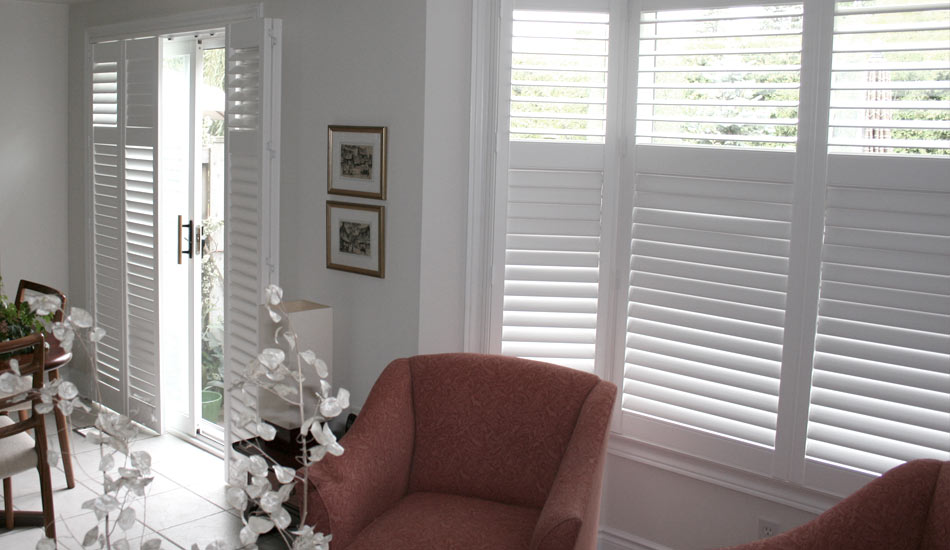 Patio Door and Bay Window dressed beautifully by  Blind Advantage with Shutters